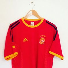 Spain home shirt, as worn at the 2002 World Cup. Link to buy is in our bio ☝️ #football #footballshirt #spain #espana #spainshirt #worldcup #worldcup2002 #retro #retroshirt #classickit #retrofootball #vintage #vintagefootball #adidas #vintageadidas #soccer #soccerjersey