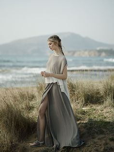 draped blouse paired with a maxi grey skirt