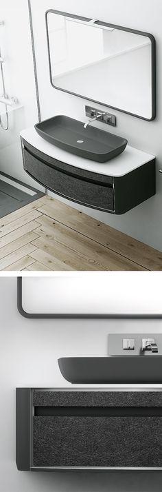 Mueble curvo suspendido con lavabo negro de sobremesa y espejo enmarcado en moldura lisa negra