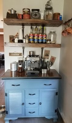 This is my beloved coffee bar! Same Breville machine that we've had forever, just finally gave it a proper place to be! I upcycled an old 70's era mini-buffet by painting it, upgrading the hardware and creating a new top out of a slab of cedar set in angle iron.