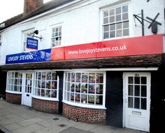 Lovejoy Stevens (Thatcham) - Signtray manufactured & installed by Kremer Signs. Simple Dibond sign tray with vinyl graphics, supplied with projector and window displays. #Fascia #EstateAgents #Signage