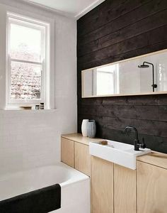 tiny contemporary bathroom in black, white and natural wood