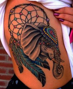 Dreamcatcher elephant tattoo - As mentioned earlier, you can decorate your dreamcatchers with anything that is sacred to you. For this lady, an elephant was necessary.