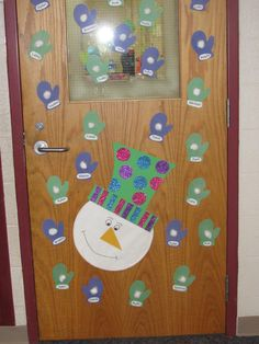 Snowman door decoration with mittens and snow (cotton) ball with students name on them