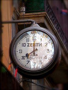 'Timeless' vintage Zenith Clock Sign in the Carrer de l'Espaseria, Barcelona Spain