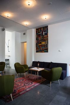 I think that's just a painting of books but how awesome would it be if it were actually an alcove filled with books?