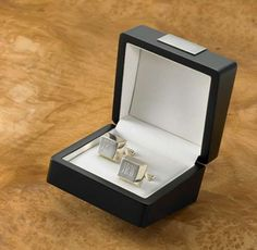 Elegant and sophisticated, these sterling silver-plated cufflinks add a sparkle to any man's formal wardrobe. Arriving in a handsome black box and personalized with the initials of the recipient, these square-shaped cuff links make a great personalized gi$53.99Regency Sterling Silver Plated Cufflinks Engraved/Customized,GC485Giftwares,Gifts for Him,Personalized Items,Ships from USA,JDS,Wedding,Baby Shower,