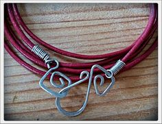 Braselet with silver wire and red leather