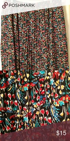 """Floral Printed Skirt This Anthropologie skirt was designed by Tabitha and is a perfect floral option for the summer/spring and I've paired it with tights and boots for fall and winter. The black base makes it versatile. There is a great elastic waistband and for me at 5'5"""", it stops at my knee. It's a great flowy and twirly option. Anthropologie Skirts"""