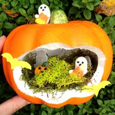 Pumpkin Fairy Garden for Halloween. You could paint the pumpkin or trim the cut edge with ribbon or Halloween decorations.  | Linzer Lane Blog