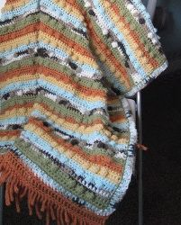 This intermediate crochet pattern is great for those who love to use the bobble stitch in their crochet projects. Use similar or different yarn colors and you'll still love the way this crochet baby blanket turns out!