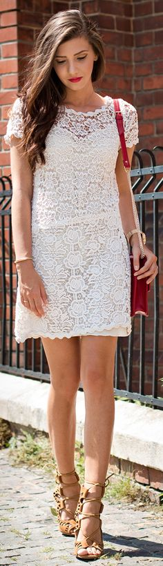 Larisa Costea is wearing a white floral print lace dress from Prada, shoes from Choies and a red bag from Cmood