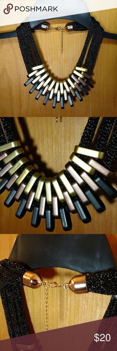 Mixed Media Statement Necklace Gold, bronze and black hang from a 3-tiered, black necklace. Rose gold, lobster claw closure with adjustable length to ensure the perfect neckline. Perfect statement piece for the holidays! Jewelry Necklaces