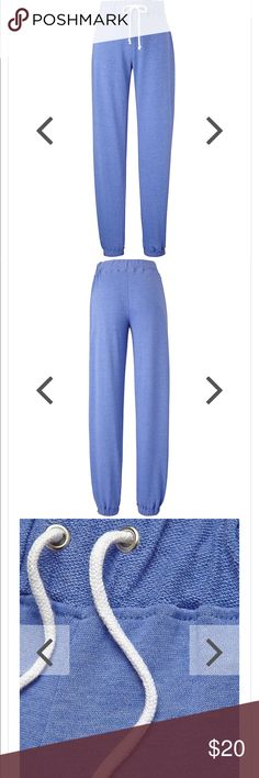 NWT Comfy Cuffed Joggers w/ Waist Tie Blue Size 22 BRAND NEW WITH TAGS!! Blue Regular fit cuffed-leg pants. Ideal for lounging or wearing to the gym. With contrast drawcord to elasticized waistband. Machine washable. 50% Cotton, 50% Polyester. Regular - to fit inside leg length 29in/74cm. Simply Be Pants Track Pants & Joggers