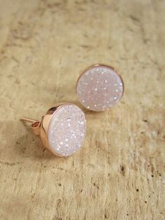 Gorgeous, natural druzy quartz stones are bezel set in rose gold vermeil ear posts with backs. Natural druzy stones have a light AB (rainbow-like) coating, which gives them a slight iridescence. These are not coated with titanium like most of the other druzy studs that I carry, so