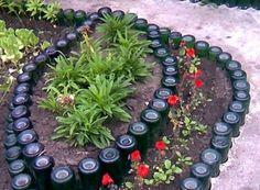 Glass Recycling Ideas for Green Building and Outdoor Home Decorating - All For Garden Wine Bottle Garden, Wine Bottle Trees, Wine Bottle Planter, Recycled Wine Bottles, Garden Edging, Garden Borders, Garden Soil, Raised Garden Beds, Garden Art