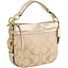 I love the hardware on this bag and how the muted gold leather accents give this otherwise neutral bag a little extra something!  - Coach