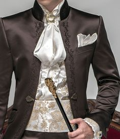 This coat and neckware is kind of amazing.  Love the jewell anyway. The poof is bit much. The jacket is amazing. love the collar and the detail near edges.  http://www.ottavionuccio.com