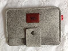 I love the Pack & Smooch iPad Mini case.  Flap for headphones - felt and leather. Look even better the right way up!
