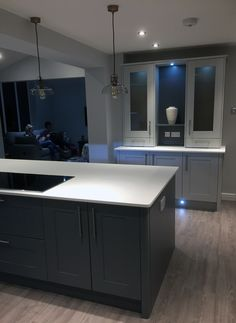 Kitchen supplied by Benchmarx Leek. Shaker cabinets are a mixture of Somerset Grey and Sherwood Grey. Work surfaces are Apollo Slab Tech Ice White. Paint is Dulux Polished Pebble