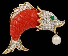 Carved fish brooch