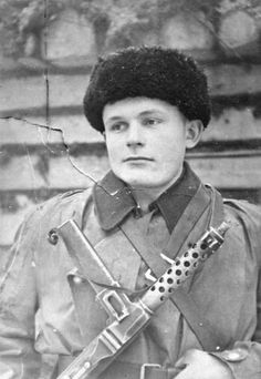 """The young Russian partisan by the nome de guerre """"Chkalov"""" (real name S.S. Jankovic) succeeded in derailing 12 German trains, a note on the original claims. He is armed with a captured German MP-34 SMG, originally by Steyr-Solothun. The M-34 was a fine weapon that remained in use by police and military forces well into the 1970s."""