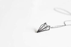 // Paper airplane necklace