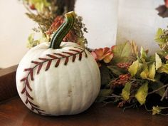 This is a fun idea for a fall baseball themed party!   DIY Painted Baseball Pumpkin Decor