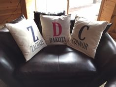 Create a pillow for each of you kids. Add a single letter initial with their name written underneath.
