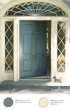 Simple, clean, but still stands out. Aura Grand Entrance by Benjamin Moore in 'Night Train' Satin provides a timeless look for this home.  #FrontDoor #Entrance