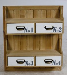 This is natural wood effect wall storage with interchangeable drawers and metal cup handles with name plates…