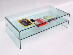 Small table, bridge rectangular shape, in curved glass with magazine or objects rack, perfect for the living room or office. Classic float trasparent glass, 12 mm thick. Size:  L 110 W 60 H 38 shelf area H 16 cm Glass thickness 12 mm