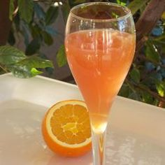 Sicilian Sunset: Ingredients   2 cups ice cubes  1 cup Prosecco (Italian sparkling wine)  1 cup orange juice  1 cup cranberry juice  2 lemons, zested