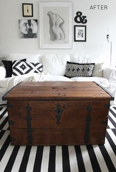 a pop of old wood in a black and white room
