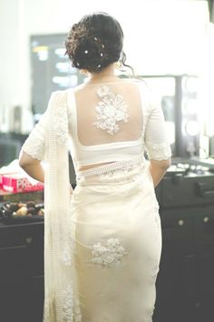Looking for latest blouse designs for net sarees? Here are 46 ultimate net blouse collections that you can rock with any saree! Blouse Back Neck Designs, White Blouse Designs, Netted Blouse Designs, Bridal Blouse Designs, Choli Designs, Saris, Sari Bluse, Blouse Designs Catalogue, Stylish Blouse Design