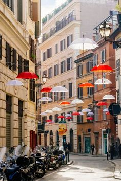 When in Rome, do as the Romans do and stroll through an umbrella-adorned street.