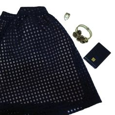 """❤️Sale❤️ Navy Checkered Mesh Skirt Dress this skirt up or down!  Go chic or punk or whatever fits your mood ⭐️ This skirt has a navy checkered mesh on top and a nude slip underneath. I've been getting away with styling it as a black skirt, it works as both haha  This skirt is meant to sit at high waist.  Waist: 28"""" Length: 16""""   No trades  Offers welcome  Extra pics by request  Same day or next day shipping ❤️ Happy Poshing! ❤️ Lush Skirts Circle & Skater"""