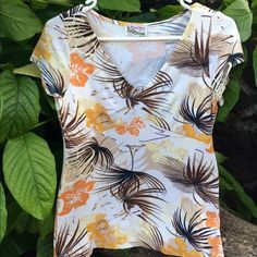 Woman's Hawaiian Print Blouse Beautiful Hawaiian Print Blouse. Stretchy, Knit/T-shirt fabric. V Neck, slip over blouse. size is petite small. Kaua'iana Tops Blouses