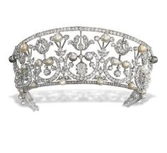 A BELLE EPOQUE TIARA Of kokoshnik design, the old-cut diamond foliate openwork band interspersed with button-shaped cultured pearls and (untested) pearls of varying hues, the centre set with a cushion-shaped diamond, adapted, circa 1905 Royal Crowns, Royal Tiaras, Tiaras And Crowns, Edwardian Jewelry, Antique Jewelry, Diamond Tiara, Diamond Cuts, Pearl Diamond, Royal Jewelry