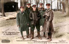 Sanke card 511 showing the star performers of Jasta 11 taken at Roucourt, in mid-April 1917, Pictured are (L-R) Sebastian Festner (12 victories), Karl-Emil Schaefer (30 victories), Manfred von Richthofen (80 victories), Lothar von Richthofen (40 victories) and Kurt Wolff (33 victories). These men accounted for 83 enemy aircraft in April 1917 alone.  (colourised by Leo Courvoisier )