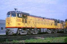 UP U50 38 Description: Union Pacific Railroad U50 38 at Council Bluffs, Iowa on June 13, 1965, Kodachrome by Lou Schmitz, Chuck Zeiler collection. Built in July 1964 (c/n 35098), placed in service July 27, 1964, retired September 25, 1973 and traded to GE, the U50 was two U25B's on a common frame (two FDL-16 four stroke prime movers coupled to two GT588 main generators producing 5000 hp total to eight GE-752A traction motors), utilizing span bolsters and trucks from retired gas-turbine…