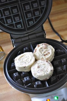 Little Bit Funky: cinnamon rolls in a waffle iron! who knew!!  Was perfect for camping (with electricity of course)!  Will do again at home.  Yields a waffle like dryness but yummy!
