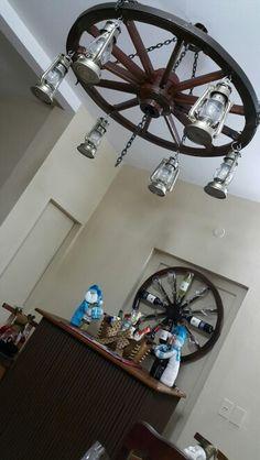 Porta vinos y copas hecho con rueda de carreta mis - Decoracion con ruedas ...