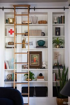 White bookshelf with rolling ladder