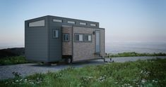 Aurora is a tiny house on wheels with two large motorized slide outs. When expanded, the tiny house measures wide and totals This double push out is the design shiznit. Awesome use of space, and yet keeping a compact. And again no Loft to climb into. Best Tiny House, Tiny House Cabin, Tiny House Living, Tiny House On Wheels, Tiny Houses, Tiny House Builders, Tiny House Design, Tiny House Mobile, Mobile Homes
