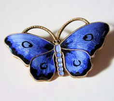 OPRO Norway Blue Enamel Sterling Butterfly Pin.  via Etsy.