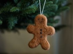 Needle felted gingerbread man with cookie cutter as template