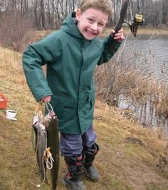 Fishing Trip Photos. He sure does look happy doesn't he. Check out the great fishing videos here by clicking the photo.