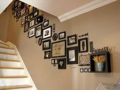 Picture frames on staircase wall: I love this look; unified though with a lot of variation in frame types, some of the items on the wall aren't even pictures. Picture frames on staircase wall: Stairway Photos, Stairway Gallery, Gallery Walls, Frame Gallery, Photowall Ideas, Photo Displays, Stairways, Home Projects, Home Improvement