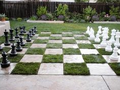 Chess board yard using stones and grass.  Where pin the world would you buy such large pieces?